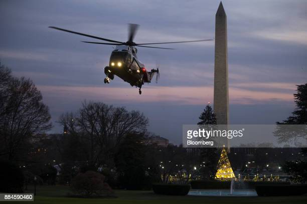 Marine One carrying US President Donald Trump prepares to land on the South Lawn of the White House in Washington DC US on Saturday Dec 2 2017 Trump...