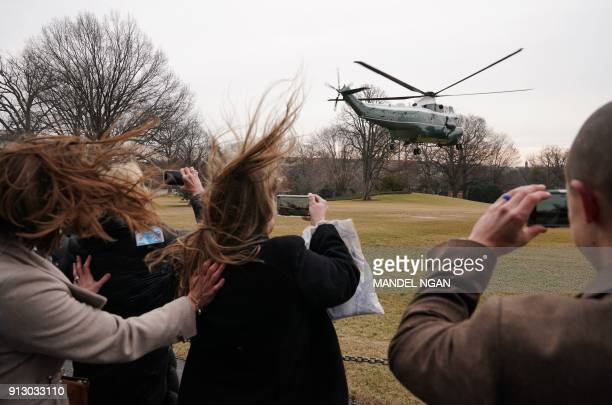 TOPSHOT Marine One carrying US President Donald Trump takes off from the South Lawn of the White House on February 1 2018 in Washington DC Trump is...