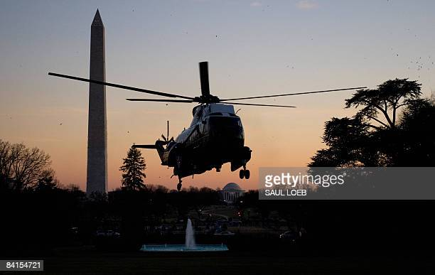 Marine One, carrying US President George W. Bush and First Lady Laura Bush arrives on the South Lawn of the White House in Washington, DC, on January...