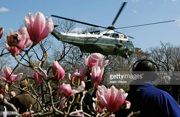 Marine One carrying US President George W Bush takes off from the south lawn of the White House March 20 2008 in Washington DC President Bush is...