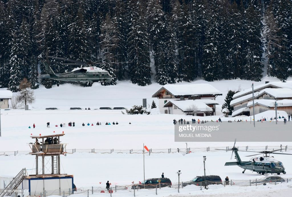 US Marine One helicopter carrying US President Donald Trump leaves Davos after the annual World Economic Forum (WEF) on January 26, 2018 in Davos, eastern Switzerland. MEDINA