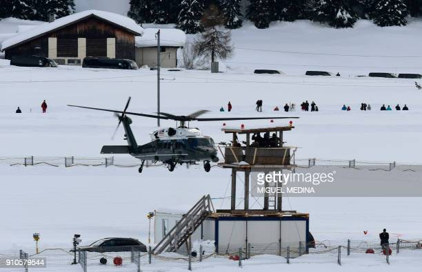 US Marine One helicopter carrying US President Donald Trump leaves Davos after the annual World Economic Forum on January 26 2018 in Davos eastern...