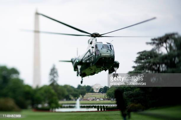 Marine One lands on the South Lawn of the White House with aboard US President Donald Trump and US first lady Melania Trump on June 7 in Washington DC
