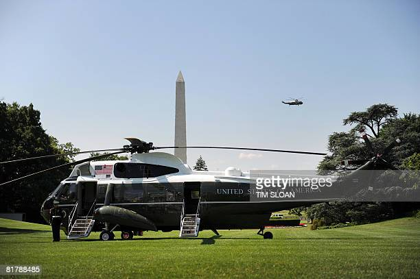 Marine One sits on the South Lawn of the White House awaiting US President George W Bush while another presidential helicopter flies by on July 1...