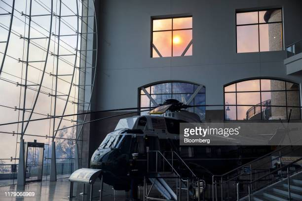 Marine One stands on display in the Ronald Reagan Presidential Library as smoke rises outside during the Easy Fire in Simi Valley California US on...