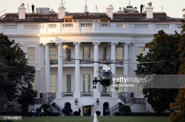 Marine One, the presidential helicopter, carries U.S. President Donald Trump away from the White House on the way to Walter Reed National Military...