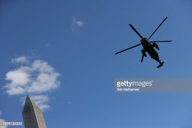 Marine One, the presidential helicopter, flies past the Washington Monument on its way to the White House to carry U.S. President Donald Trump to...