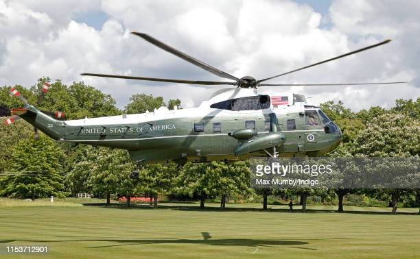 Marine One the United States Marine Corps Helicopter carrying US President Donald Trump and Melania Trump comes in to land in the garden of...