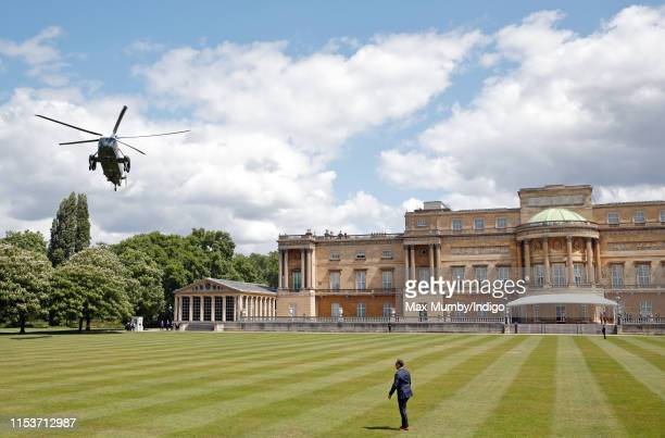 Marine One, the United States Marine Corps Helicopter, carrying U.S. President Donald Trump and Melania Trump comes in to land in the garden of...