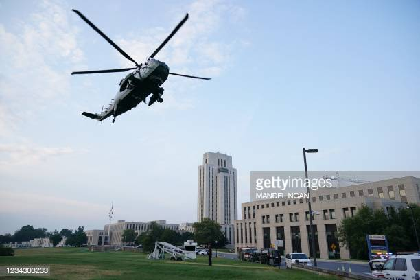 Marine One upon with US President Joe Biden on board approaches Walter Reed Medical Center in Bethesda, Maryland on July 29, 2021. - The First Lady...