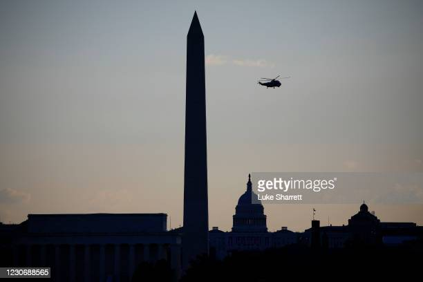 Marine One, with President Donald J. Trump onboard, flies above the National mall enroute to Joint Base Andrews on January 20, 2021 in Washington,...