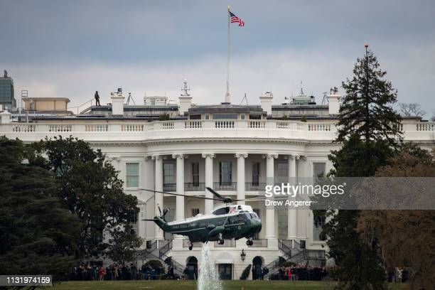 Marine One with President Donald Trump onboard departs the South Lawn of the White House March 22 2019 in Washington DC Trump is traveling to his...