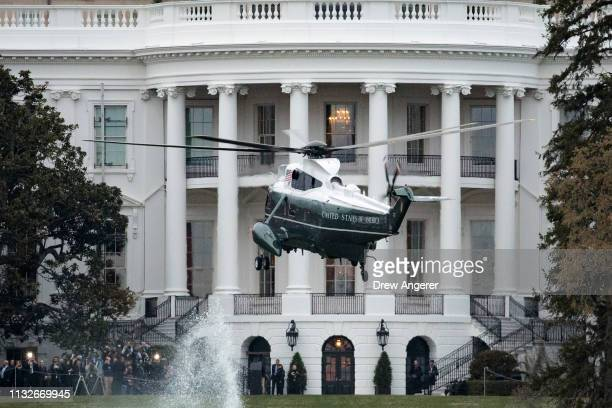 Marine One with President Donald Trump onboard prepares to land on the South Lawn of the White House March 24 2019 in Washington DC Trump returns to...