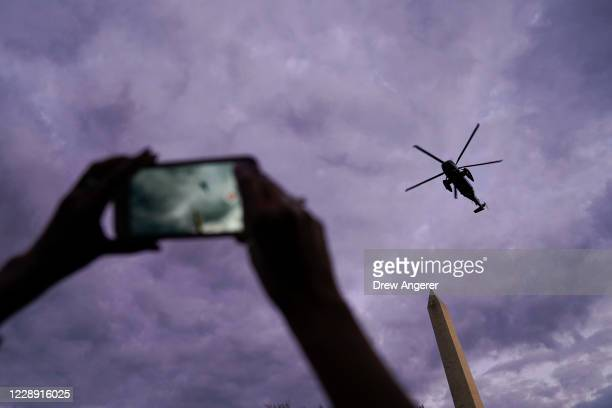 Marine One, with President Donald Trump onboard, prepares to land on the South Lawn of the White House on October 5, 2020 in Washington, DC. Trump...