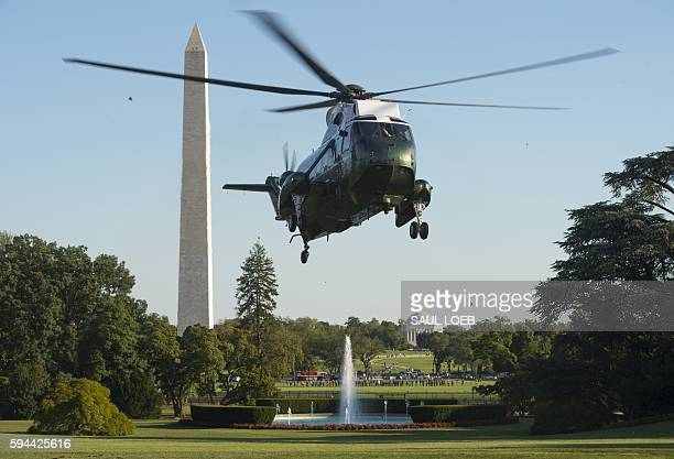 Marine One with US President Barack Obama aboard prepares to land on the South Lawn of the White House in Washington, DC, August 23 after traveling...