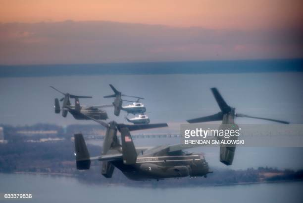 Marine One with US President Donald Trump flies with a decoy and support helicopters to Dover Air Force Base February 1 2017 in Dover Delaware for...