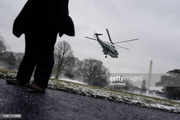 Marine One with US President Donald Trump on board departs the South Lawn of the White House in Washington DC US on Friday Feb 1 2019 Donald...