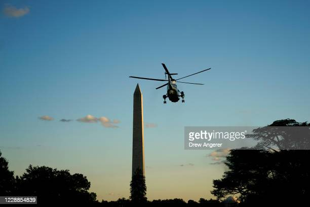 Marine One, with U.S. President Donald Trump onboard, leaves the White House for Walter Reed National Military Medical Center on the South Lawn of...