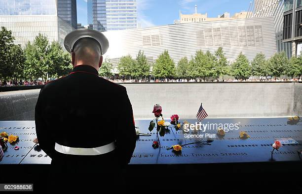 S Marine pauses at one of the pools at the National September 11 Memorial following a morning commemoration ceremony for the victims of the terrorist...