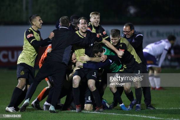 Marine players celebrate winning the match after the final whistle during the Emirates FA Cup Second Round match between Marine FC and Havant and...