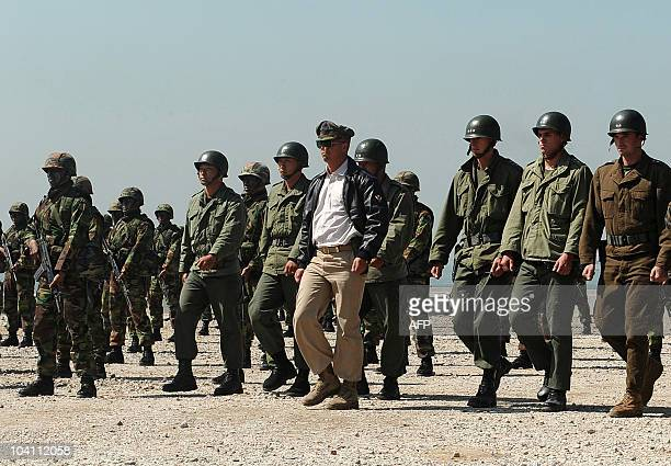 Marine playing the role of US General Douglas MacArthur and other Marines playing the roles of US and South Korean generals participate in the 60th...
