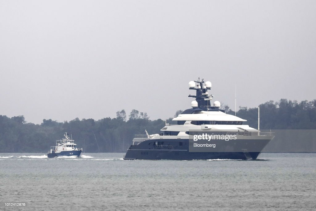 A Marine Police Boat Left Escorts The Super Yacht Equanimity As It