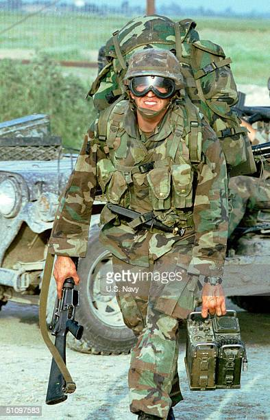 Marine Prepares To Their Amphibious Ready Group, As U.S. Air Force Security Forces Move In To Relive Their Post At Camp Hope, Albania June 4, 1999.