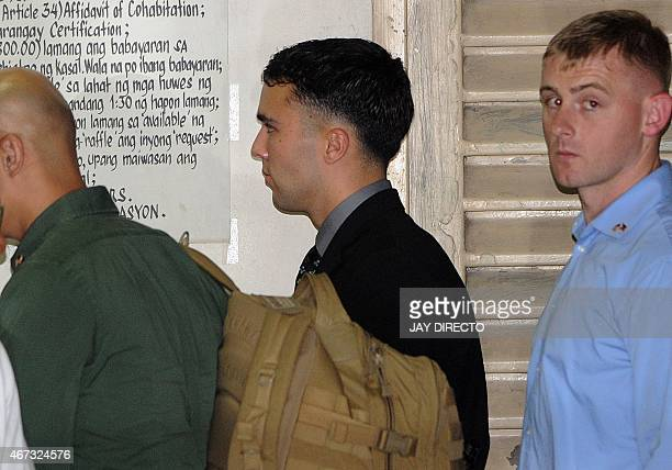 US Marine Private First Class Joseph Scott Pemberton leaves a court building in the Philippine city of Olongapo some two hours outside Manila on...