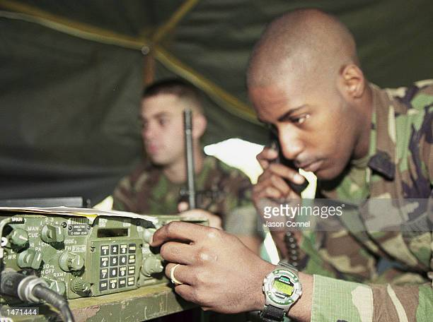 Marine Private Nathan Gaffney and Sergeant Mark Miller practice their radio skills at Camp Atterbury October 11 2002 in Edinburg Indiana The base...