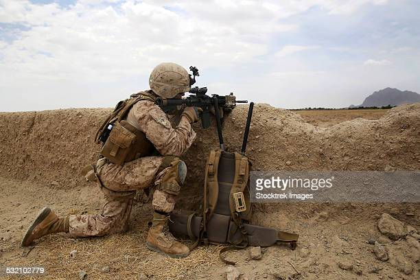 u.s. marine provides security from behind a mud wall. - us marine corps stock pictures, royalty-free photos & images