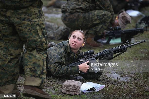 Marine recruit Angela Nowak of Midland Michigan fires on the rifle range during boot camp February 25 2013 at MCRD Parris Island South Carolina...