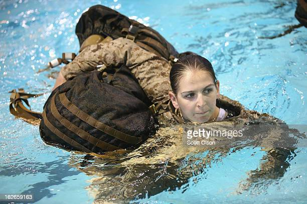 Marine recruit Chelsey Courtney of Coon Rapids Minnesota hauls a backpack while swimming in her uniform as she is tested to determine her swimming...