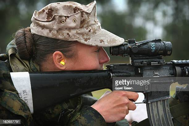 Marine recruit Cora Ann Lacher from Manuet NY fires on the rifle range during boot camp February 25 2013 at MCRD Parris Island South Carolina All...