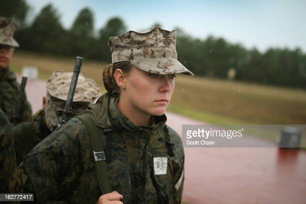 Marine recruit Jacklyn Powers from Des Moines Iowa waits with other female recruits to fire on the rifle range during boot camp February 25 2013 at...