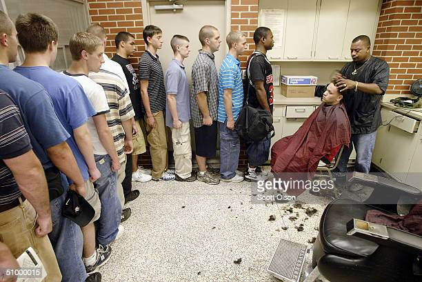 Marine recruits line up to get their first haircuts shortly after arriving at the United States Marine Corps Recruit Depot in the early morning hours...