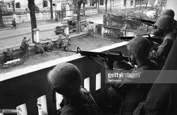 A US Marine rifleman in an elevated position is seen here as he keeps a close watch over buddies about to storm a Viet Cong stronghold in Hue The...