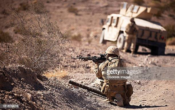 U.S. Marine scans his area while on patrol.