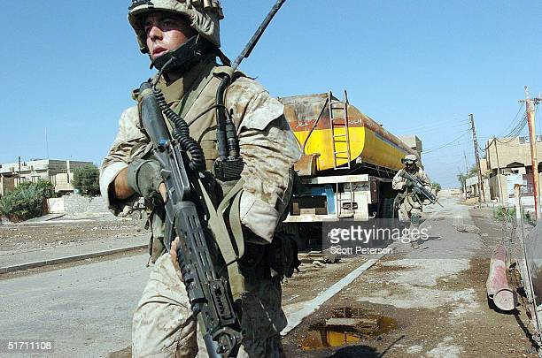 Marine scouts of the Light Armor Reconnaissance try to clear a street November 9 2004 in Fallujah Iraq On the authority of Interim Prime Minister...