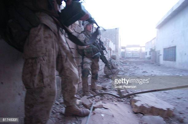 S Marine scouts of the Light Armored Reconnaissance Raider platoon move to clear two suspect warehouses in a predawn raid on November 15 2004 in...