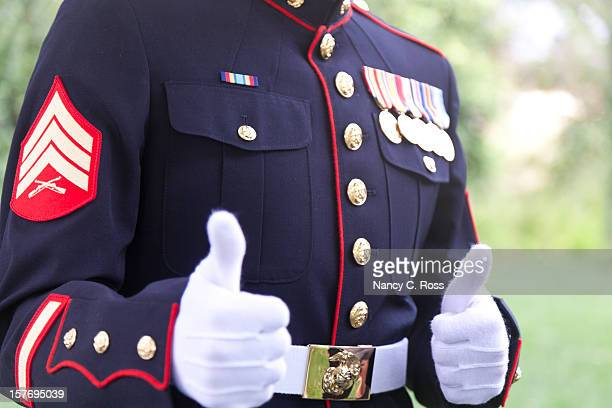 marine sergeant gives thumbs up gesture - us military emblems stock pictures, royalty-free photos & images