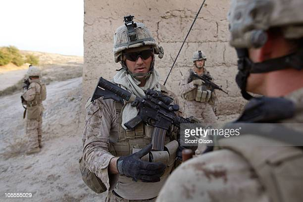 S Marine Sgt Joshua Frasier with India Battery 3rd Battalion 12th Marine Regiment directs explosive ordnance disposal technicians to an improvised...