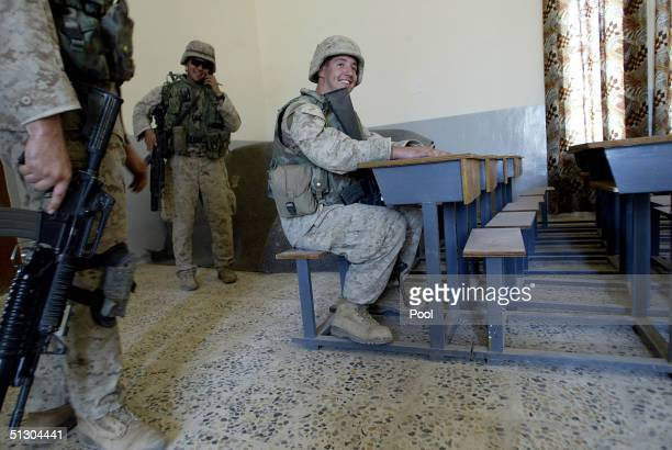 S Marine sits at a desk in a newly refurbished school while patrolling on September 14 2004 in the Iraqi Holy city of Najaf Weeks of battles between...