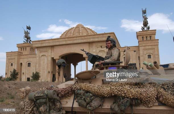 Marine sits on his light armored viechcle in front of Saddam Hussein Palace April 14 2003 in Tikrit which is located approximately 175 km north of...
