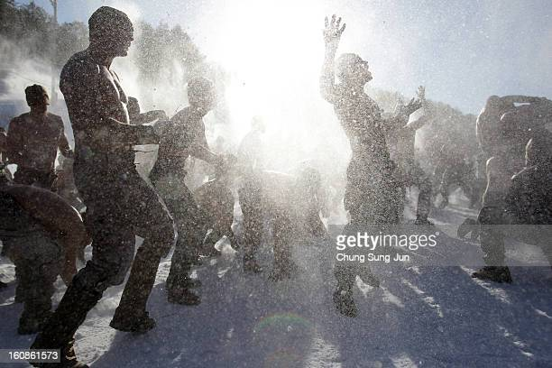 S marine soldiers from 1st battalion 3rd marine deployed from Hawaii and South Korean marine soldiers cover themselves in snow during the US and...