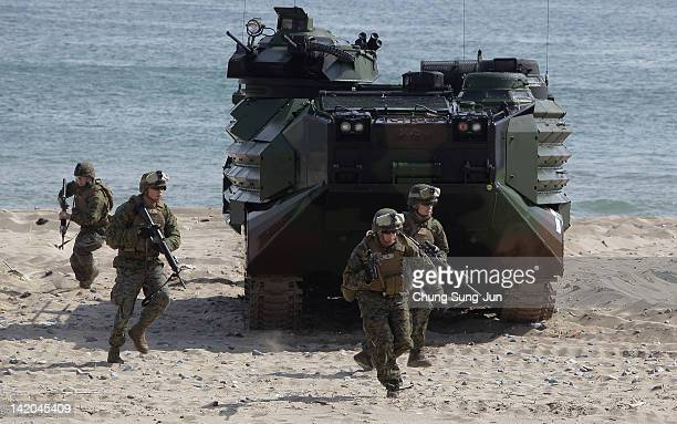 Marine soldiers from 31st Marine Expeditionary Unit, Battalion landing team deployed from Okinawa, Japan, exit an Amphibious Assault Vehicle during...