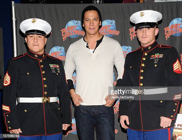 Marine Staff Sergeant Daniel Valdesactor Chaske Spencer and Marine Sergeant Joel Adams visit Planet Hollywood Times Square to collect toys for the...