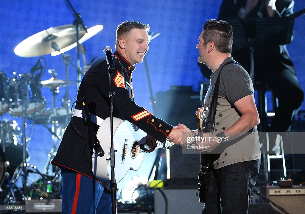 Marine Staff Sgt Brandon Valentine Performs With Musician Jay DeMarcus Of  Rascal Flatts Onstage During ACM