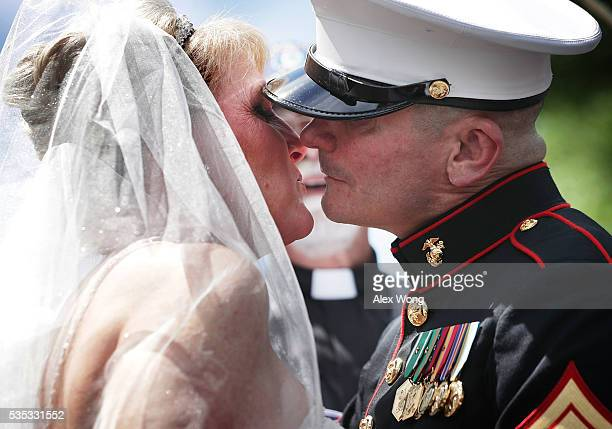Marine Staff Sgt Tim Chambers 'the saluting Marine' kisses his bride Lorraine Heist prior to the annual Rolling Thunder First Amendment Demonstration...
