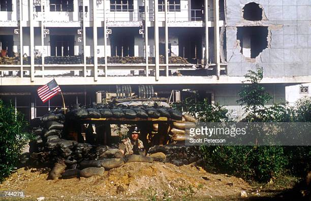 Marine stands duty in a heavily fortified bunker January 10, 1993 near a recently captured cantonment of weapons belonging to a Somali clan in...