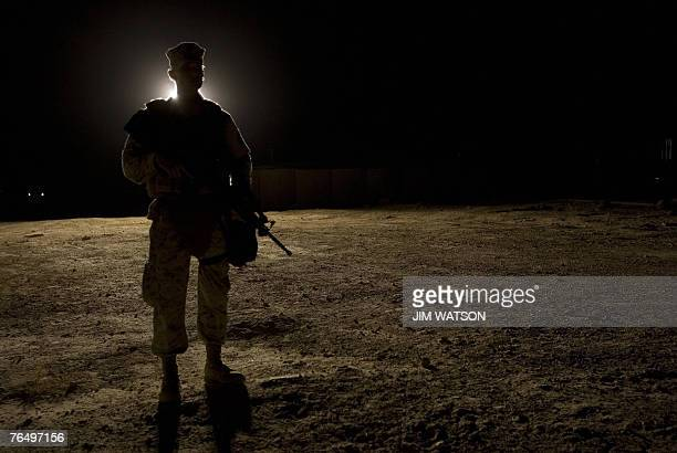 Marine stands guard as US President George W Bush visits AlAsad Air Base in Anbar Province Iraq 03 September 2007 Bush said during a surprise visit...